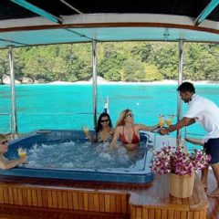 Luxury Sailing & Motor Catamaran drinks served in the top deck jacuzzi