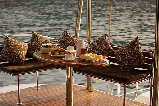 Luxury Sailing & Motor Catamaran breakfast on the aft deck