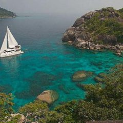 Luxury Sailing & Motor Catamaran under sail in the Similans