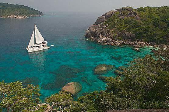 Luxury Sailing & Motor Catamaran under sail in the Similans