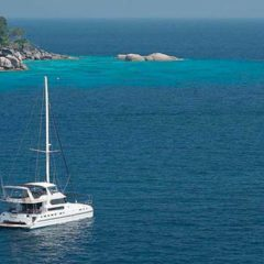 Luxury Sailing & Motor Catamaran close to shore in Phuket