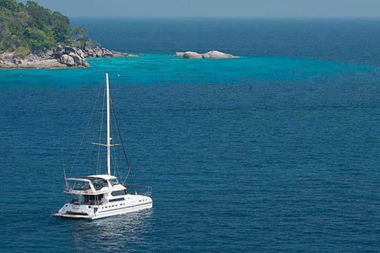 Luxury Sailing & Motor Catamaran close to shore in Phuket