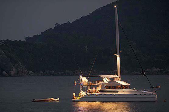 Luxury Sailing & Motor Catamaran on a sunset cruise