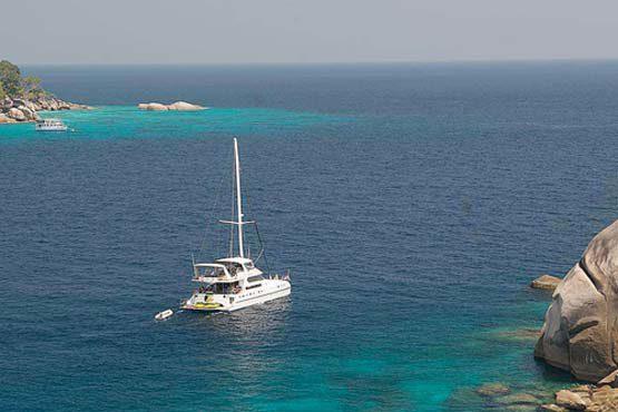 Luxury Sailing & Motor Catamaran heading out to sea