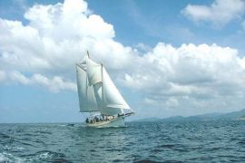 Classic Schooner Sailing Yacht under full sail off Phuket