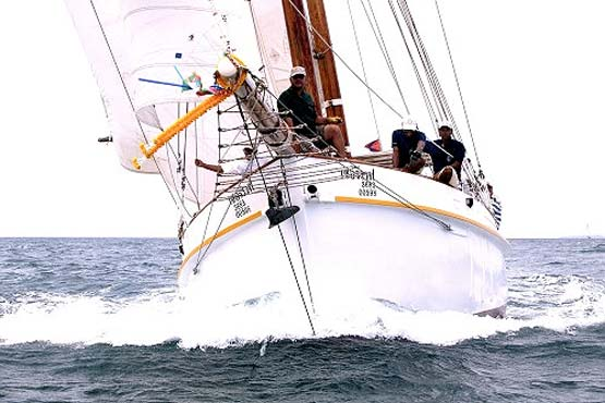 Classic Schooner Sailing Yacht powering through the waves