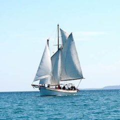 Classic Schooner Sailing Yacht heading out from port