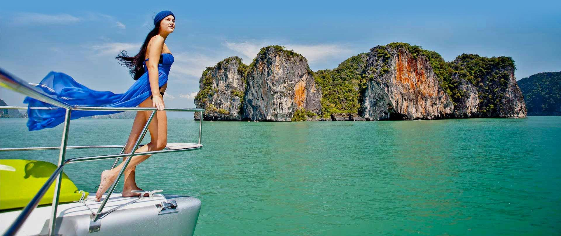 epic yacht charters titanic moment with a beautiful girl standing on the prow of our motor yacht - epic yacht charters phuket